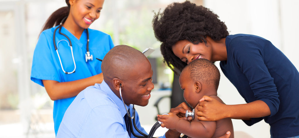 doctors checking the health of a child